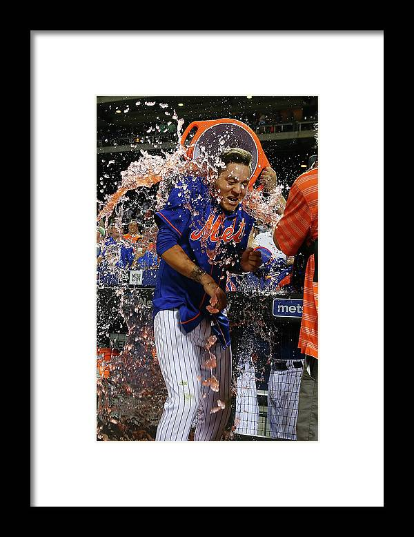 Three Quarter Length Framed Print featuring the photograph Wilmer Flores by Mike Stobe