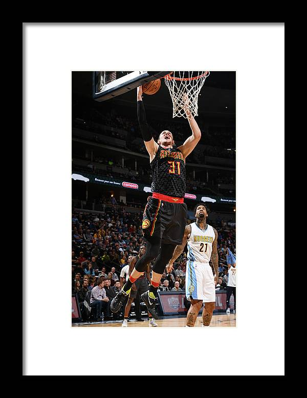Nba Pro Basketball Framed Print featuring the photograph Wilson Chandler and Mike Muscala by Garrett Ellwood