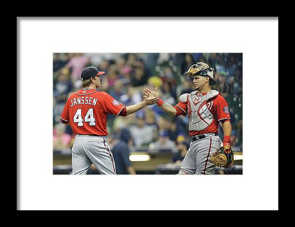 Three Quarter Length Framed Print featuring the photograph Wilson Ramos and Casey Janssen by Mike Mcginnis