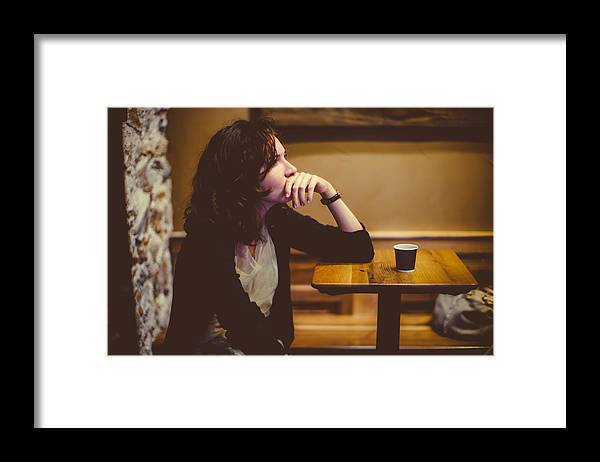 Confusion Framed Print featuring the photograph Woman deep in thought at the bar by Photo by Rafa Elias