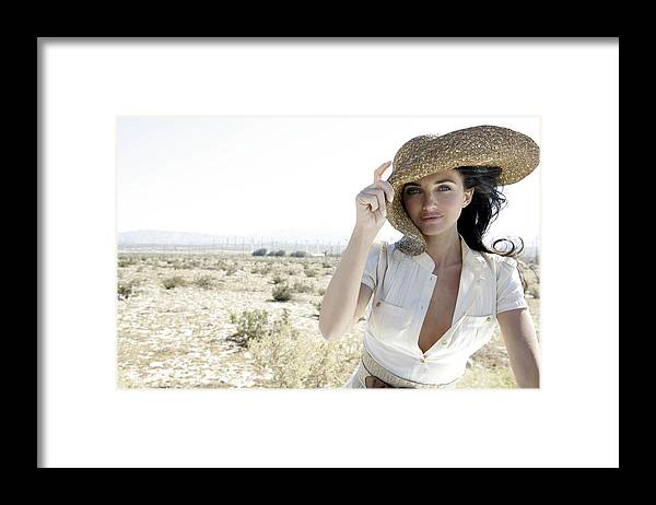 Wind Framed Print featuring the photograph Woman outdoors holding large hat by Eye Candy Images