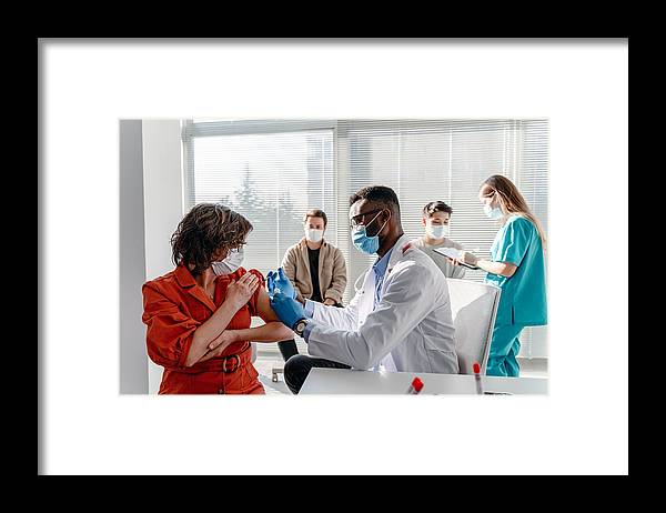 Young Men Framed Print featuring the photograph Women With Face Mask Getting Vaccinated, Coronavirus, Covid-19 And Vaccination Concept by Phynart Studio