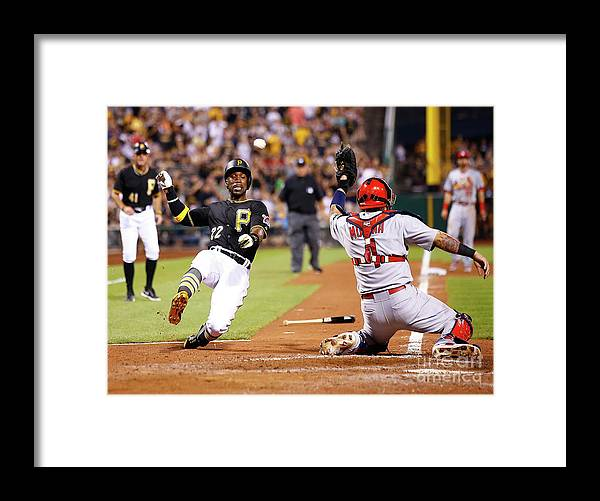 St. Louis Cardinals Framed Print featuring the photograph Yadier Molina and Andrew Mccutchen by Jared Wickerham
