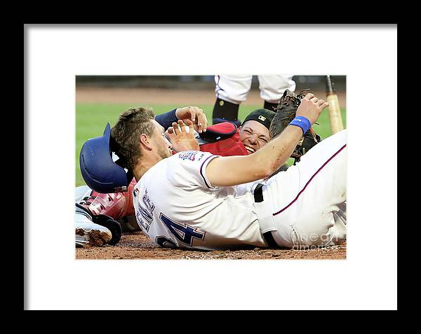 People Framed Print featuring the photograph Yadier Molina And Hunter Pence by Ronald Martinez