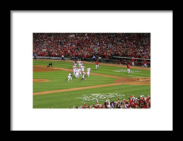 St. Louis Cardinals Framed Print featuring the photograph Yadier Molina and Jason Motte by Dilip Vishwanat