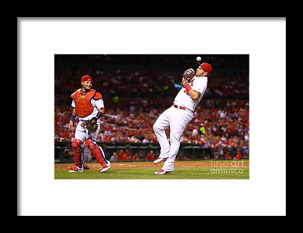 St. Louis Cardinals Framed Print featuring the photograph Yadier Molina and Matt Adams by Dilip Vishwanat