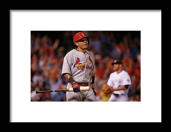 St. Louis Cardinals Framed Print featuring the photograph Yadier Molina and Scott Oberg by Doug Pensinger