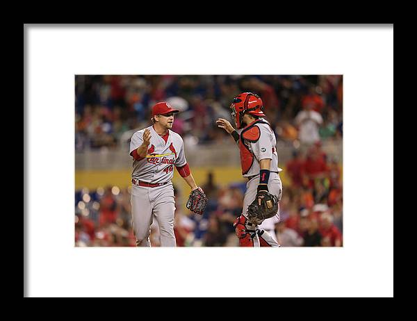 St. Louis Cardinals Framed Print featuring the photograph Yadier Molina and Trevor Rosenthal by Rob Foldy