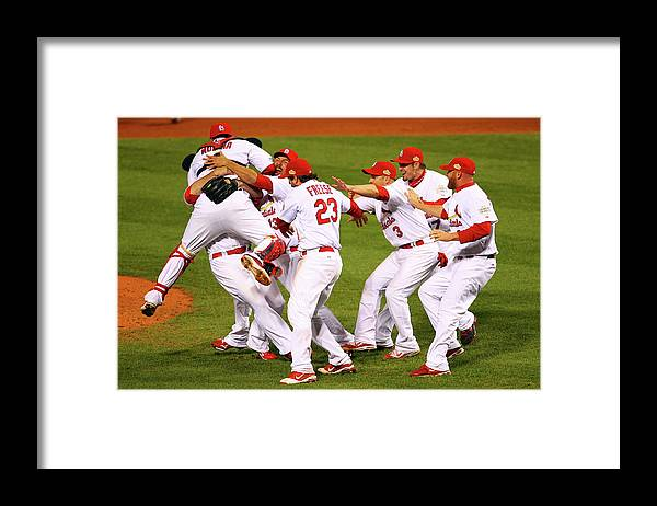 St. Louis Cardinals Framed Print featuring the photograph Yadier Molina, Gerald Laird, and David Freese by Dilip Vishwanat