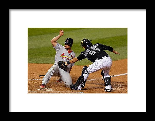 St. Louis Cardinals Framed Print featuring the photograph Yadier Molina, Matt Holliday, And Ramon Hernandez by Doug Pensinger