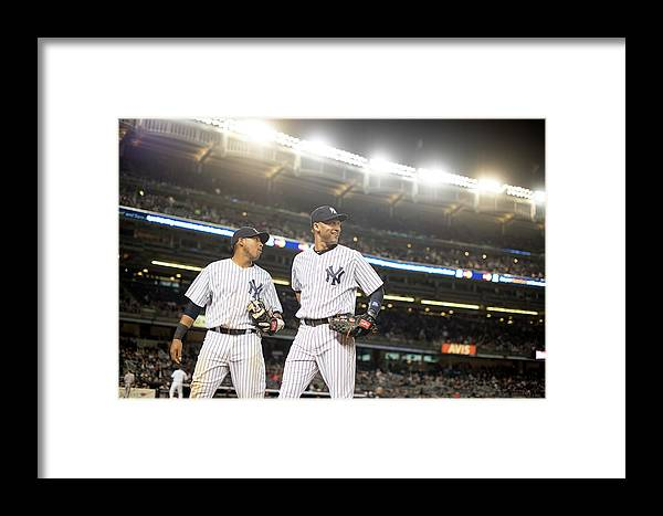 American League Baseball Framed Print featuring the photograph Yangervis Solarte And Derek Jeter by Rob Tringali