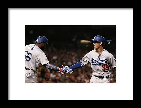 Three Quarter Length Framed Print featuring the photograph Yasiel Puig and Cody Bellinger by Christian Petersen