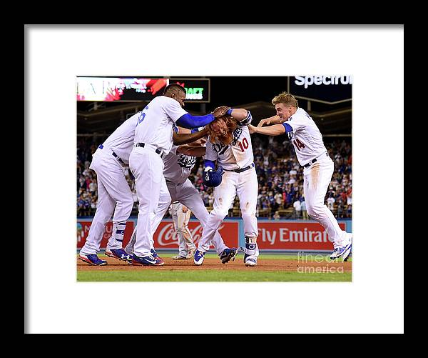 Ninth Inning Framed Print featuring the photograph Yasiel Puig and Justin Turner by Harry How