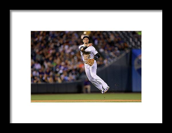 Ball Framed Print featuring the photograph Yasiel Puig and Troy Tulowitzki by Justin Edmonds