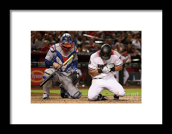 Baseball Catcher Framed Print featuring the photograph Yasmani Grandal And David Peralta by Christian Petersen