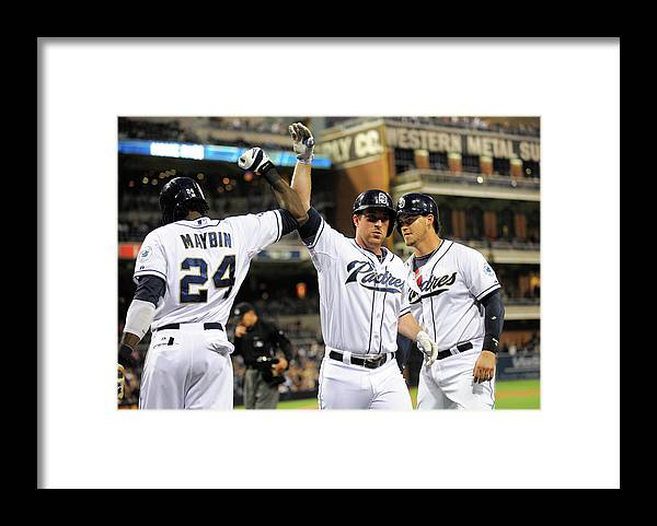 Second Inning Framed Print featuring the photograph Yasmani Grandal, Cameron Maybin, and Jedd Gyorko by Denis Poroy