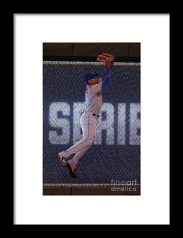 Game Two Framed Print featuring the photograph Yoenis Cespedes and Alex Rios by Christian Petersen