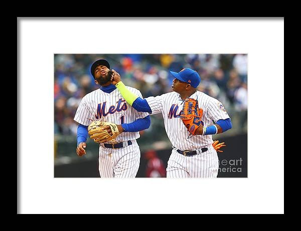 Yoenis Cespedes Framed Print featuring the photograph Yoenis Cespedes and Amed Rosario by Mike Stobe