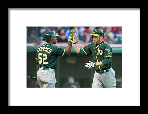 Yoenis Cespedes Framed Print featuring the photograph Yoenis Cespedes and Brandon Moss by Jason Miller
