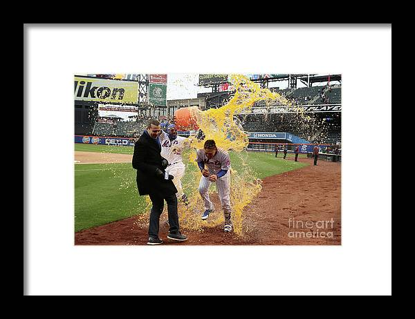 Yoenis Cespedes Framed Print featuring the photograph Yoenis Cespedes and Wilmer Flores by Al Bello