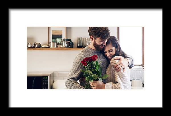 Young Men Framed Print featuring the photograph You Don't Need A Reason To Give Her Flowers by PeopleImages