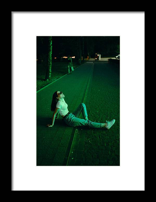 Cool Attitude Framed Print featuring the photograph Young woman in sunglasses in neon lighting by Masha Raymers