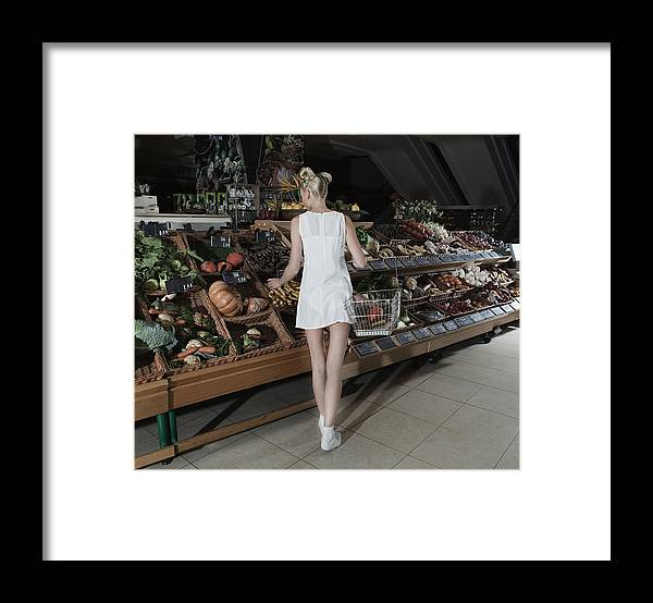 Nightdress Framed Print featuring the photograph Young Woman Shopping Vegetables In Mall by Frank Rothe