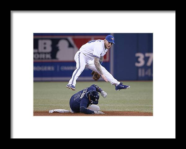 Double Play Framed Print featuring the photograph Yunel Escobar and Brett Lawrie by Tom Szczerbowski