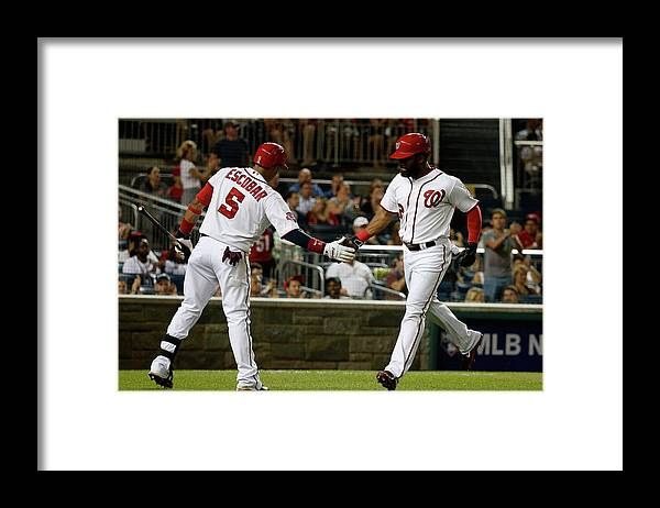 People Framed Print featuring the photograph Yunel Escobar and Denard Span by Rob Carr