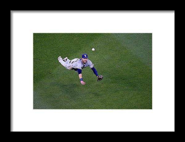 Second Inning Framed Print featuring the photograph Yunel Escobar and Kevin Kiermaier by Rob Carr