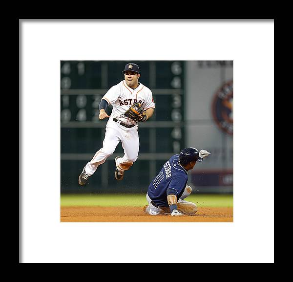 Double Play Framed Print featuring the photograph Yunel Escobar by Bob Levey