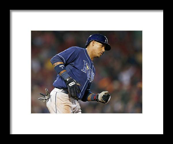 Game Two Framed Print featuring the photograph Yunel Escobar by Jim Rogash