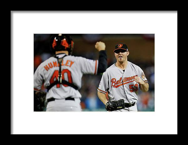 American League Baseball Framed Print featuring the photograph Zach Britton and Nick Hundley by Gregory Shamus