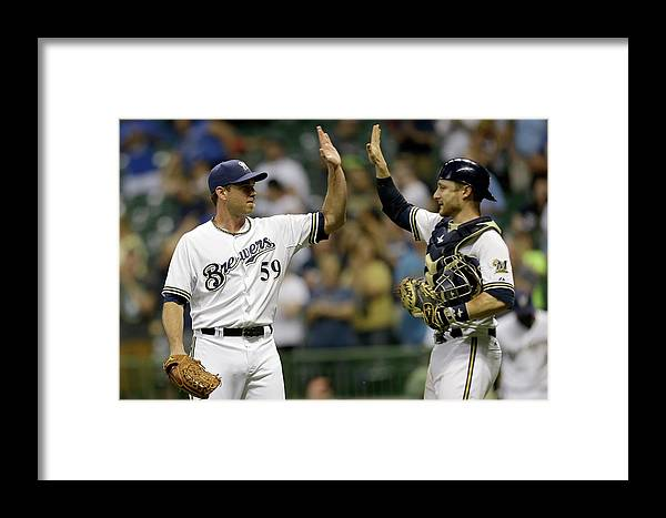 American League Baseball Framed Print featuring the photograph Zach Duke And Jonathan Lucroy by Mike Mcginnis