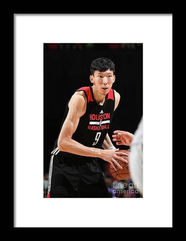 Nba Pro Basketball Framed Print featuring the photograph Zhou Qi by Garrett Ellwood