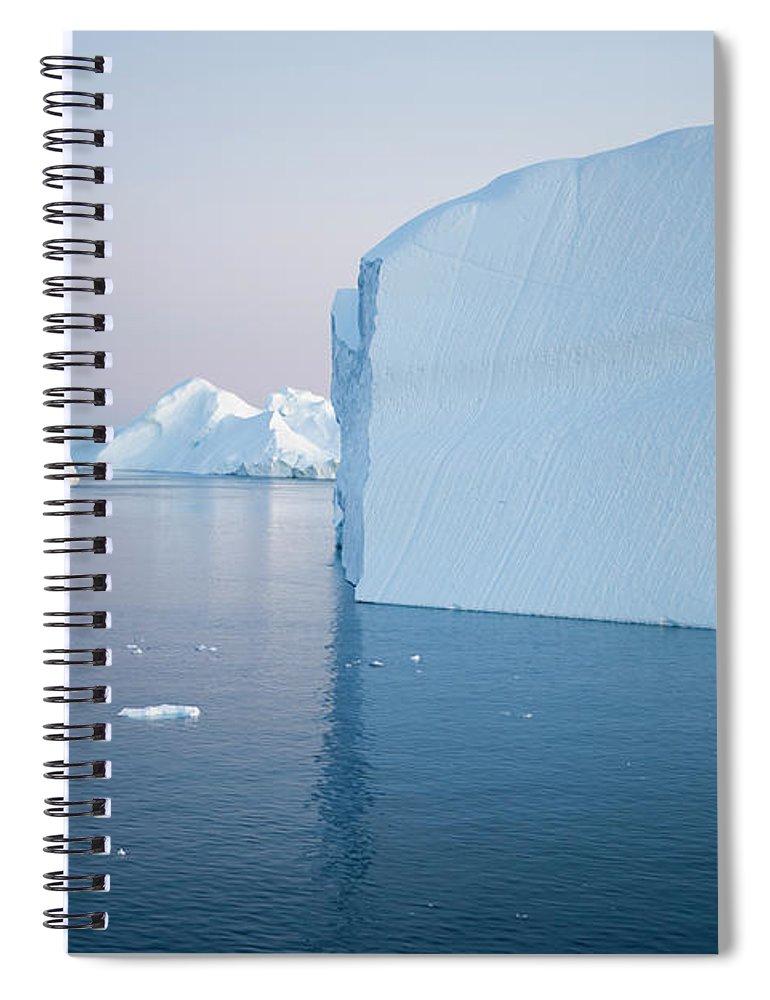 Melting Spiral Notebook featuring the photograph Icebergs Of Ilulissat Kangerlua by Holger Leue