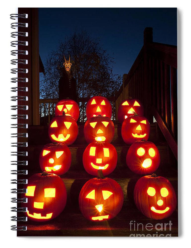 31st Spiral Notebook featuring the photograph Lit Pumpkins With Demon On Halloween by Jim Corwin