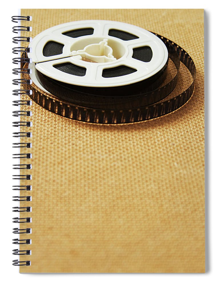 The Media Spiral Notebook featuring the photograph A Reel, Or Spool, Of 8mm Movie Film by Jon Schulte
