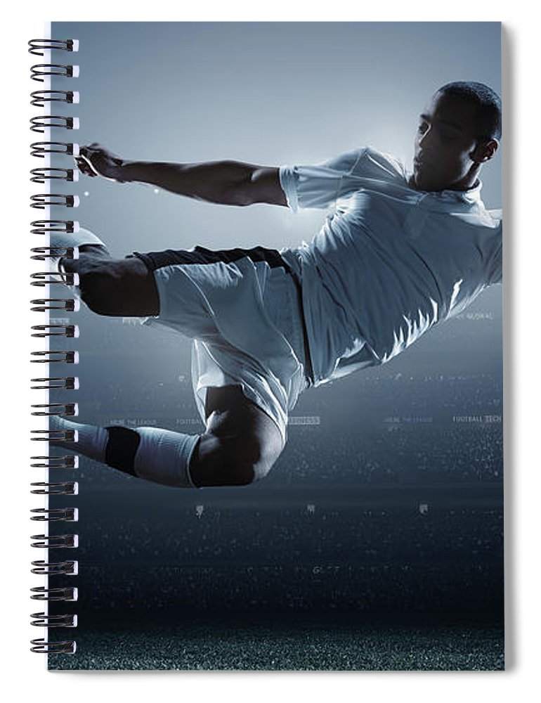 Goal Spiral Notebook featuring the photograph Soccer Player Kicking Ball In Stadium by Dmytro Aksonov