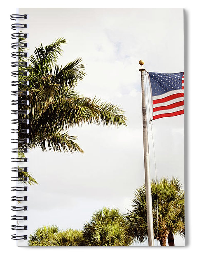Tranquility Spiral Notebook featuring the photograph American Flag Flying Amongst Palm Trees by Ron Levine