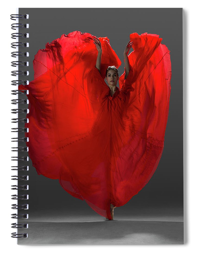 Ballet Dancer Spiral Notebook featuring the photograph Ballerina On Pointe With Red Dress by Nisian Hughes