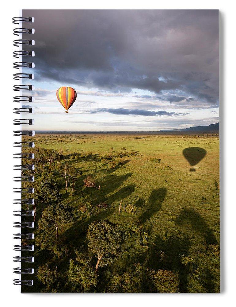 Kenya Spiral Notebook featuring the photograph Balloon In Masai Mara National Park by Luis Davilla