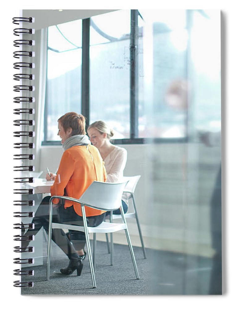 Young Men Spiral Notebook featuring the photograph Businesspeople Having Meeting At by Zero Creatives