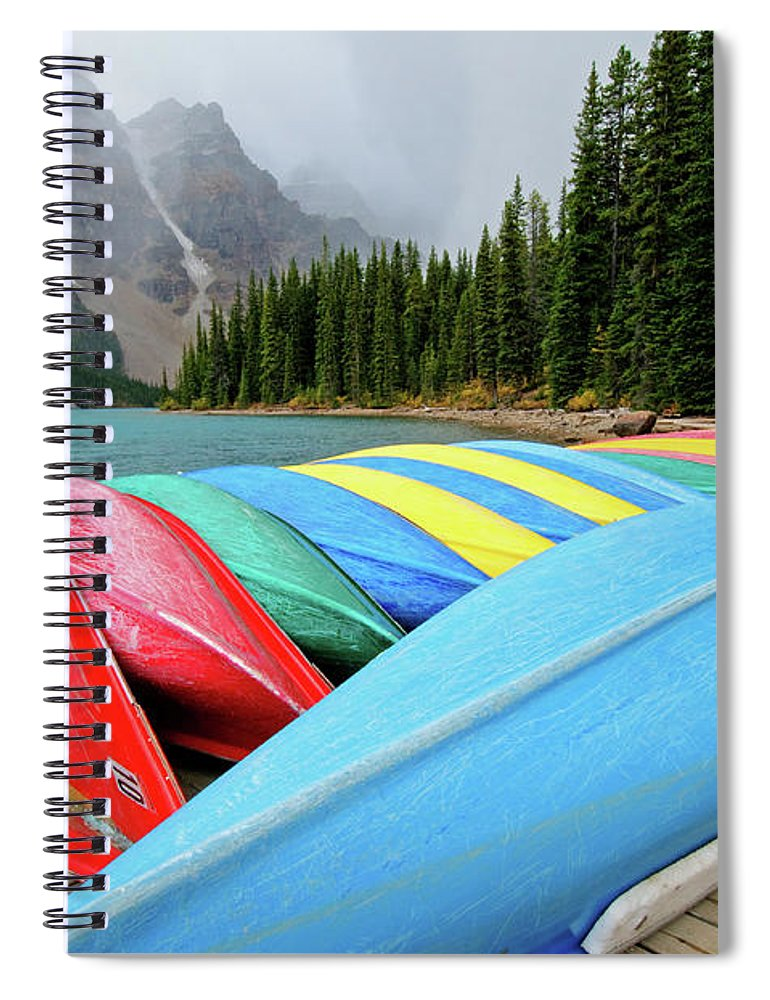 Scenics Spiral Notebook featuring the photograph Canoes Line Dock At Moraine Lake, Banff by Wildroze