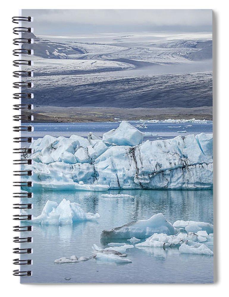 Jokulsarlon Spiral Notebook featuring the photograph Chasing Ice by Evelina Kremsdorf