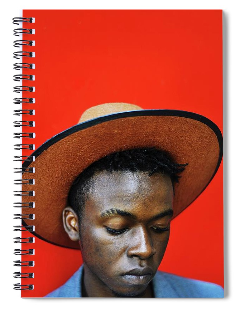 Young Men Spiral Notebook featuring the photograph Close-up Of Man Wearing Hat Against Red by Samson Wamalwa / Eyeem