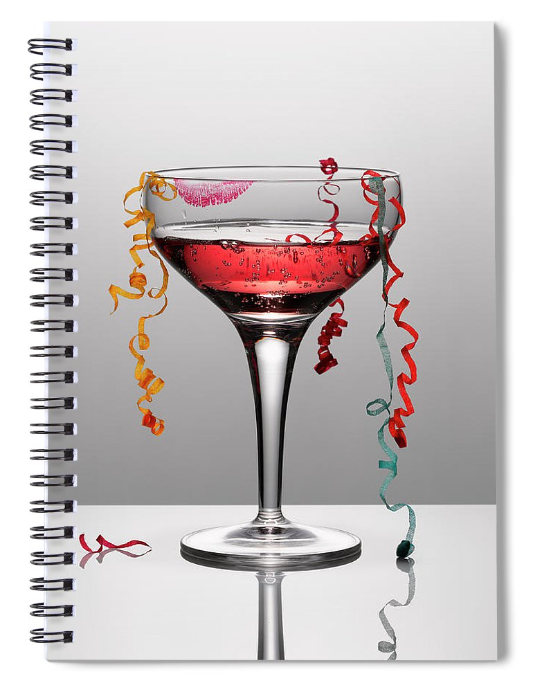 Streamer Spiral Notebook featuring the photograph Confetti Hanging From Glass Of Pink by Andy Roberts