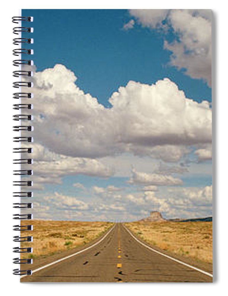 Scenics Spiral Notebook featuring the photograph Desert Road With Cloud Formations Above by Gary Yeowell