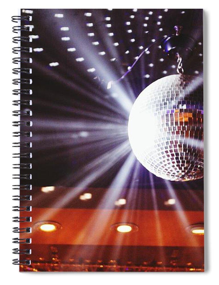 Hanging Spiral Notebook featuring the photograph Disco Ball At Illuminated Nightclub by Shaun Wang / Eyeem