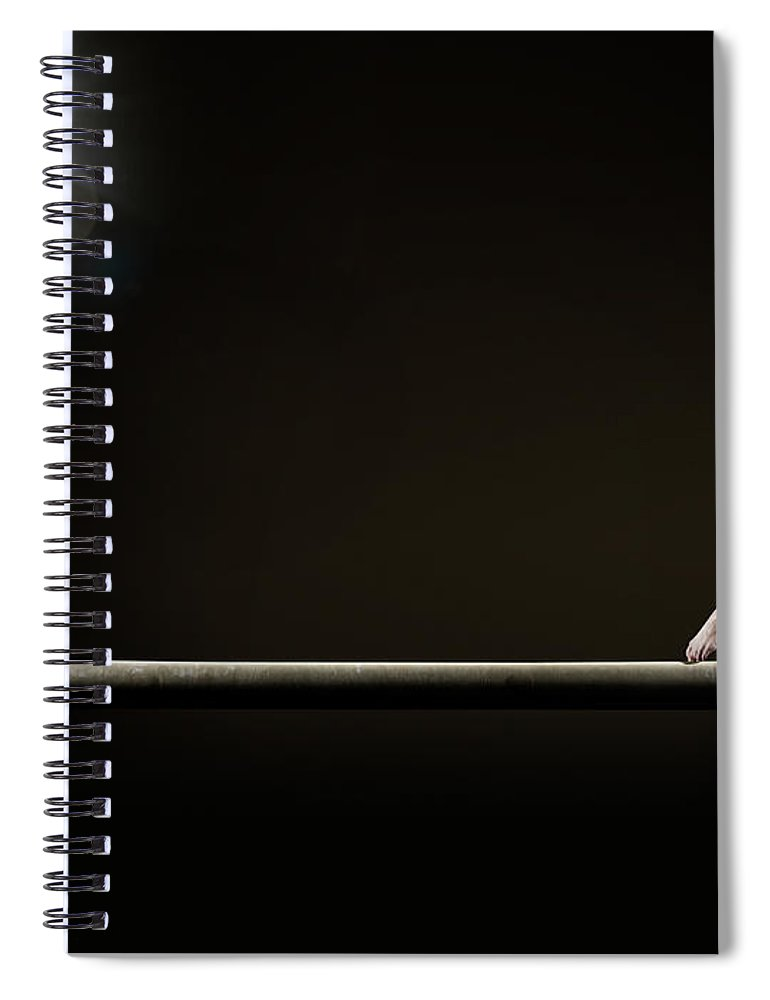 Human Arm Spiral Notebook featuring the photograph Female Gymnast Balancing On Beam by Mike Harrington
